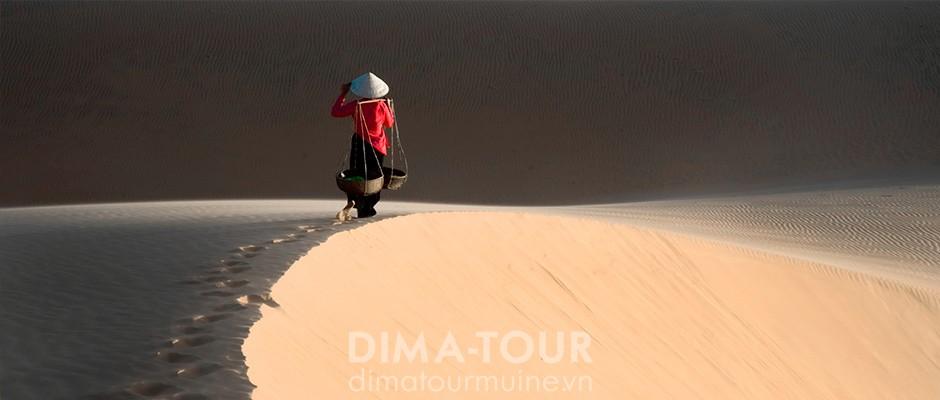 White sand dunes and lotus lake near Mui Ne, Vietnam